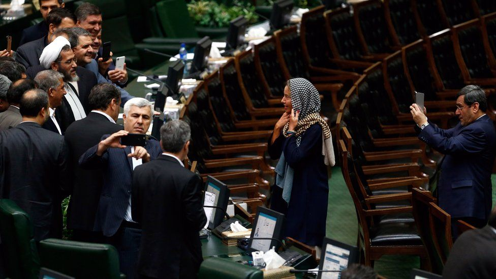 Iranian lawmakers take souvenir picture with EU foreign policy chief Federica Mogherini at the Iranian parliament after president Hassan Rouhani was sworn-in for his second four-year term of presidency, at the parliament in Tehran, Iran