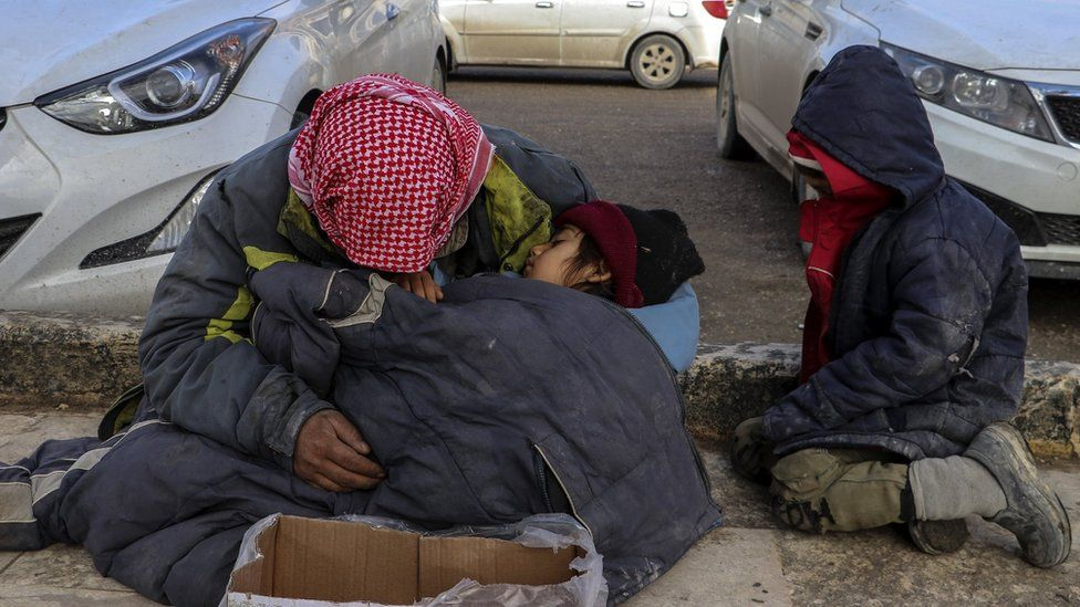 A Syrian man begs for money for his family on a roadside in Manbij, northern Syria (31 December 2018)