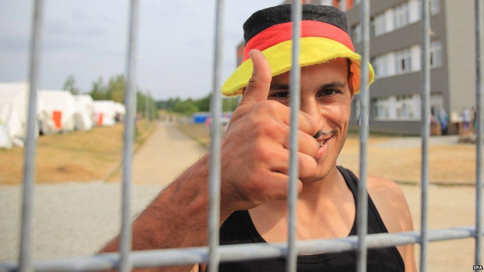 22-year-old Ali from Aleppo in Syria gives thumbs-up at the central reception centre for asylum seekers in Halberstadt, Germany (12 August 2015)