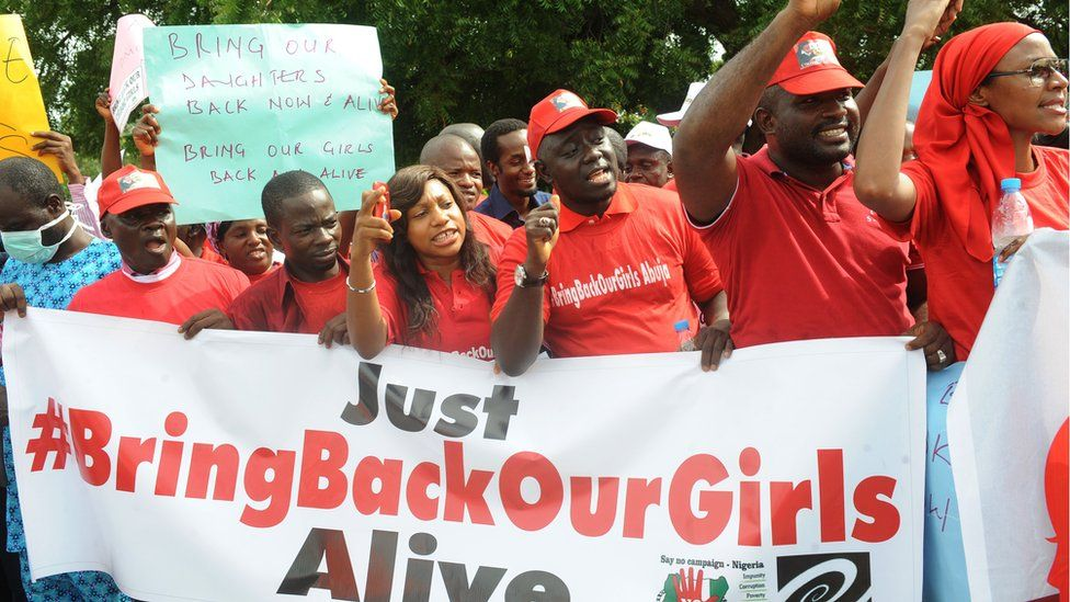 Members of civil society groups protest the abduction of Chibok school girls in Abuja on May 6, 2014, ahead of World Economic Forum.