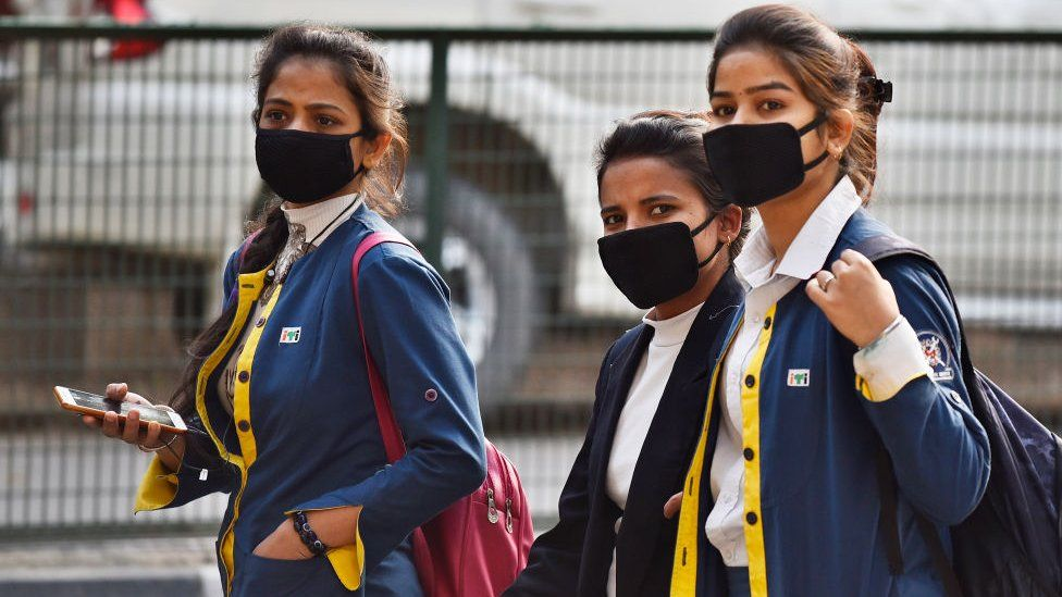 Students wearing protective masks as a precautionary measure following multiple positive cases of Coronavirus in the country