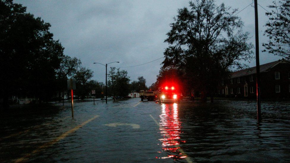 A vehicle in a flooded street in the North Carolina city of New Bern