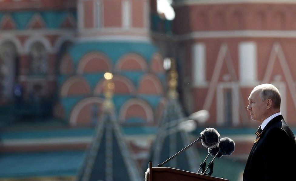 Vladimir Putin (R) delivers a speech during the military parade in the Red Square in Moscow, Russia, 24 June 2020