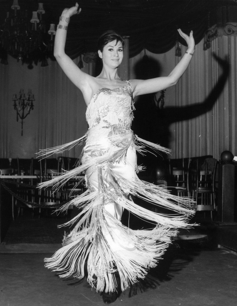 April Ashley during her song and dance act at the Astor Club, London, in 1962