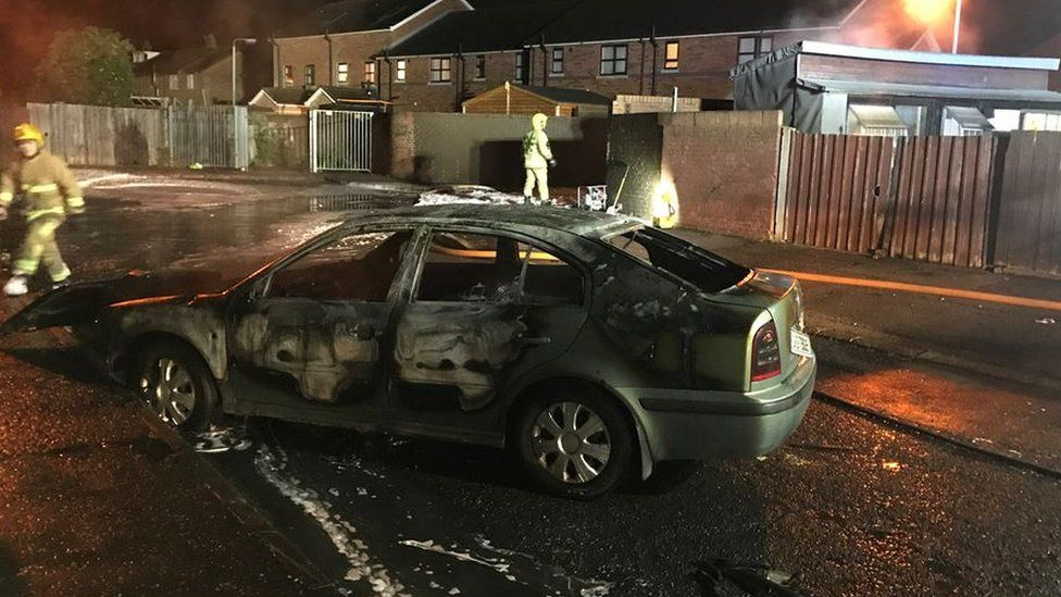 One of the burnt out cars on Etna Drive
