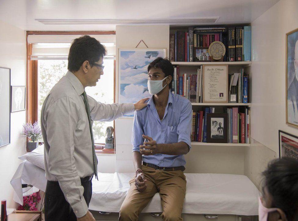 Dr Zarir Udwadia speaks to a patient