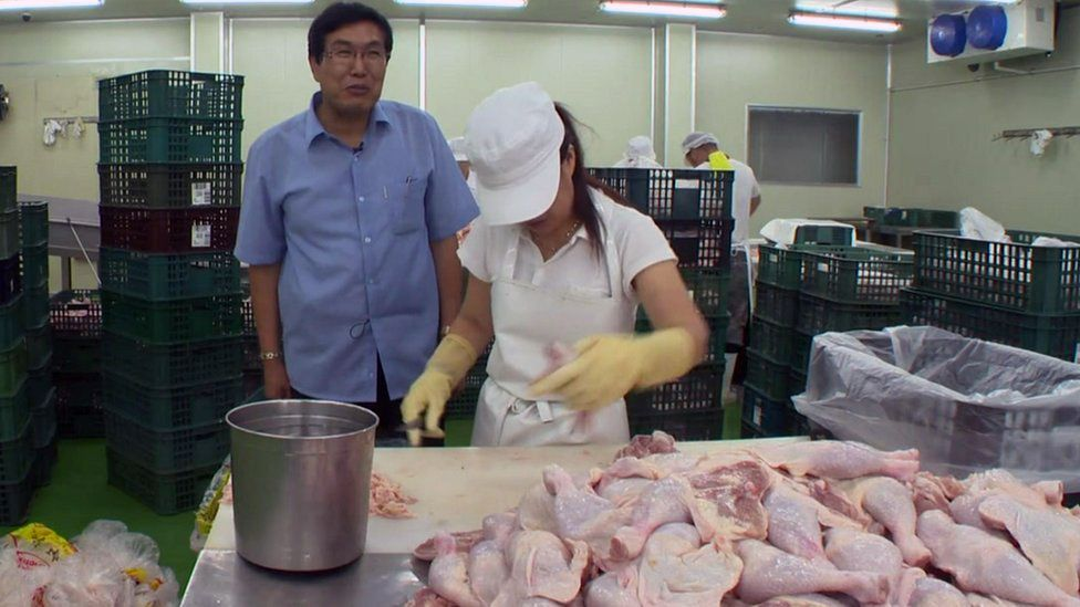 Kim Song-il at his chicken cutting business