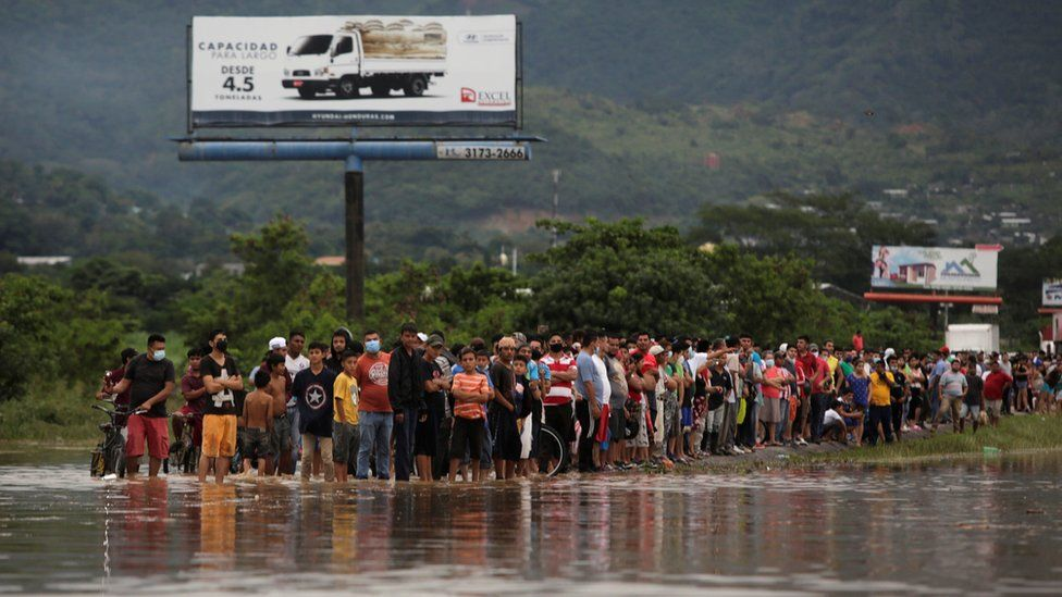 People look at a flooded street during the passage of Storm Eta, in Pimienta, Honduras November 5, 2020