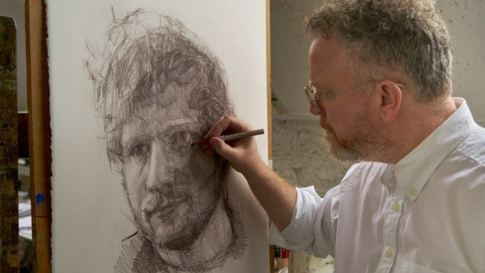 Colin Davidson drawing a portrait of Ed Sheeran