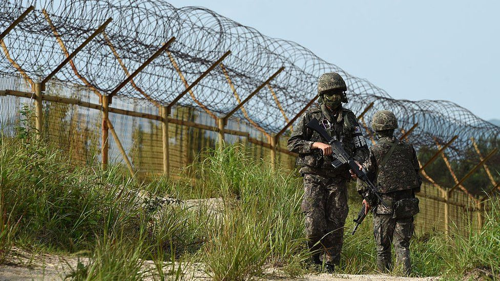 In this handout photo provided by the South Korean Defense Ministry on August 10, 2015, South Korean soldiers patrol near the scene where planted landmines exploded on August 4, maiming two soldiers on border patrol in the demilitarized zone dividing North and South Korea, on 9 August 2015 in Paju, South Korea.