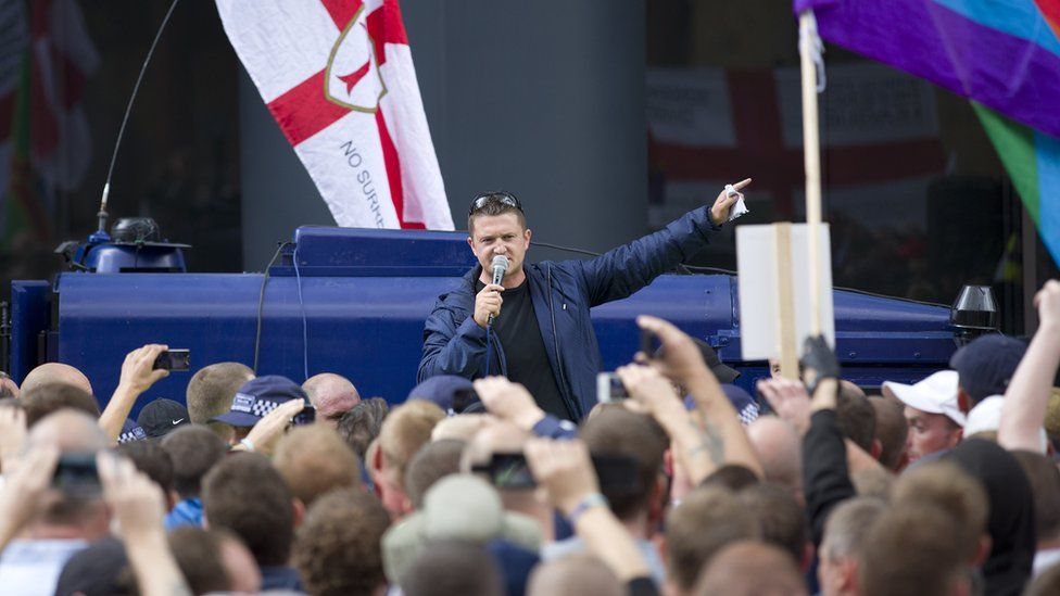 Leader of the right-wing EDL (English Defence League) Tommy Robinson (C) aka Stephen Yaxley-Lennon speaks to his followers at a protest in central London on September 7, 2013.