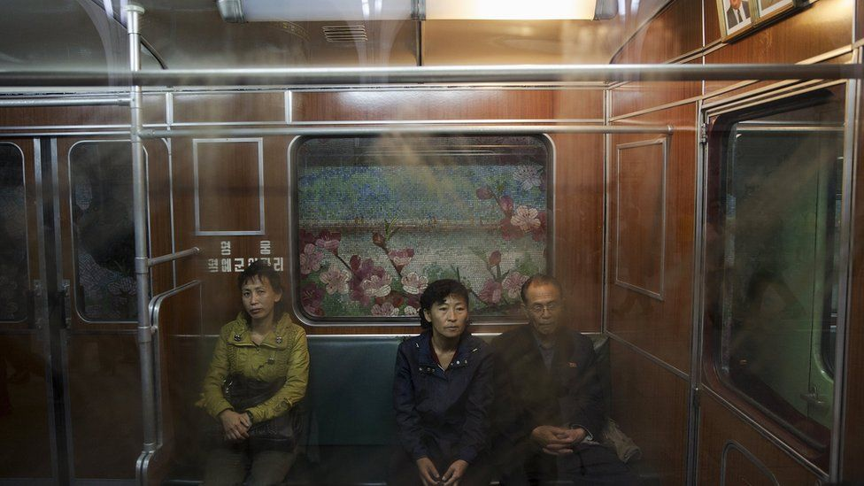 Passengers travel on a train that stopped at a subway station visited by foreign reporters during a government organised tour in Pyongyang, North Korea, October 9, 2015.