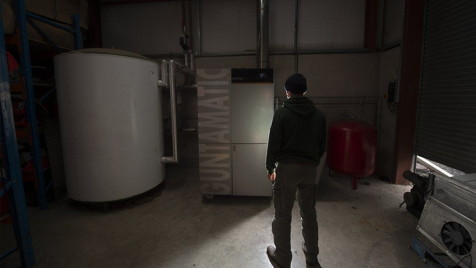 Man standing by boiler