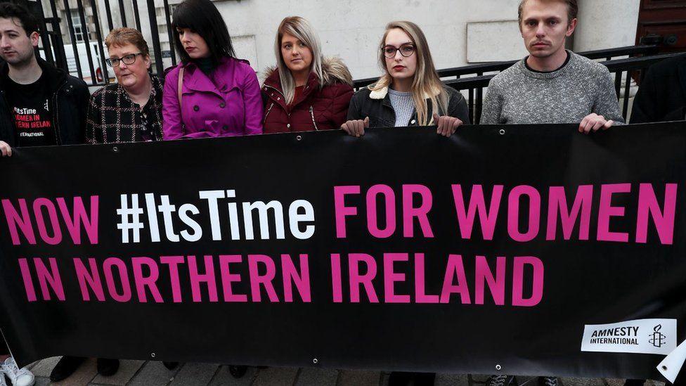 Sarah Ewart (third right) arrives with her mother Jane Christie (second left) and Grainne Teggart (third left) of Amnesty International at Belfast's High Court
