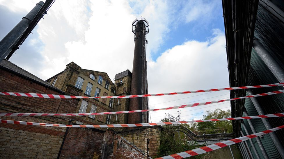 Burnt-out telephone mast in Huddersfield UK