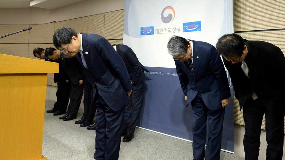 Executives of Ministry of Culture, Sports and Tourism bow as they release a statement of apology to the nation at the government complex in Sejong, South Korea, on 23 January 2017