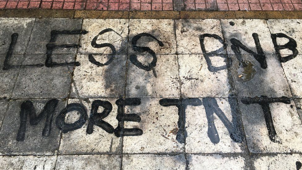 'Less BNB, more TNT' - message spray painted on the floor in Exarchia.