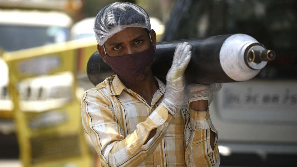 A person waiting outside an oxygen-filling centre to refill their empty cylinder at Sector-14, IDC colony near Maharana Pratap Chowk, on April 26, 2021 in Gurgaon, India.
