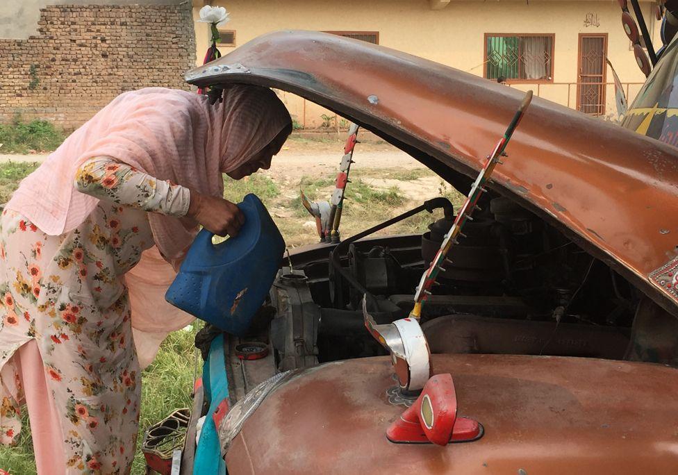 Shamim Akhtar looks under bonnet of truck