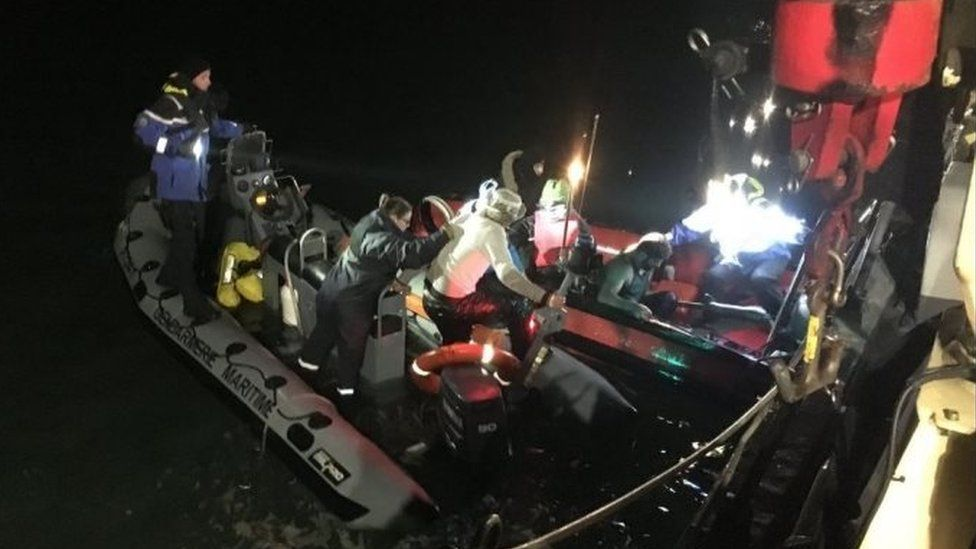 Migrants rescued from a small boat off the coast of Calais on Christmas Day