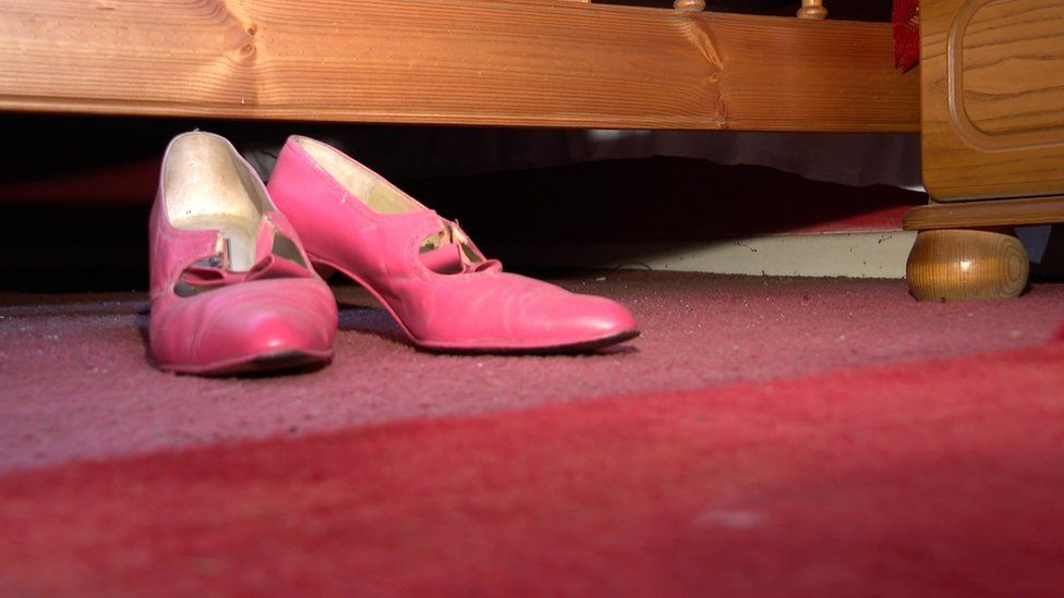 Red shoes Margaret wore when she was presented with an MBE by the Prince of Wales