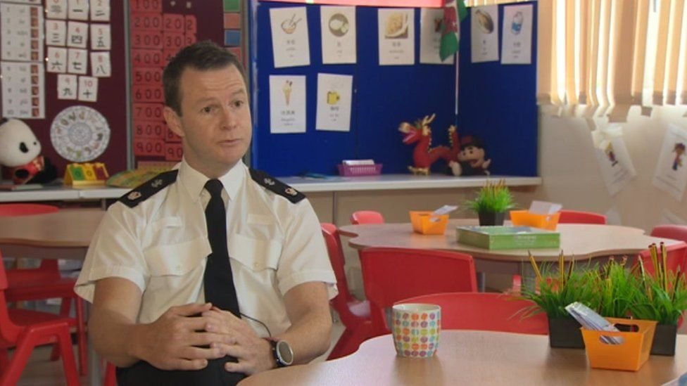 Supt Mike Richards of Gwent Police, sitting in a classroom