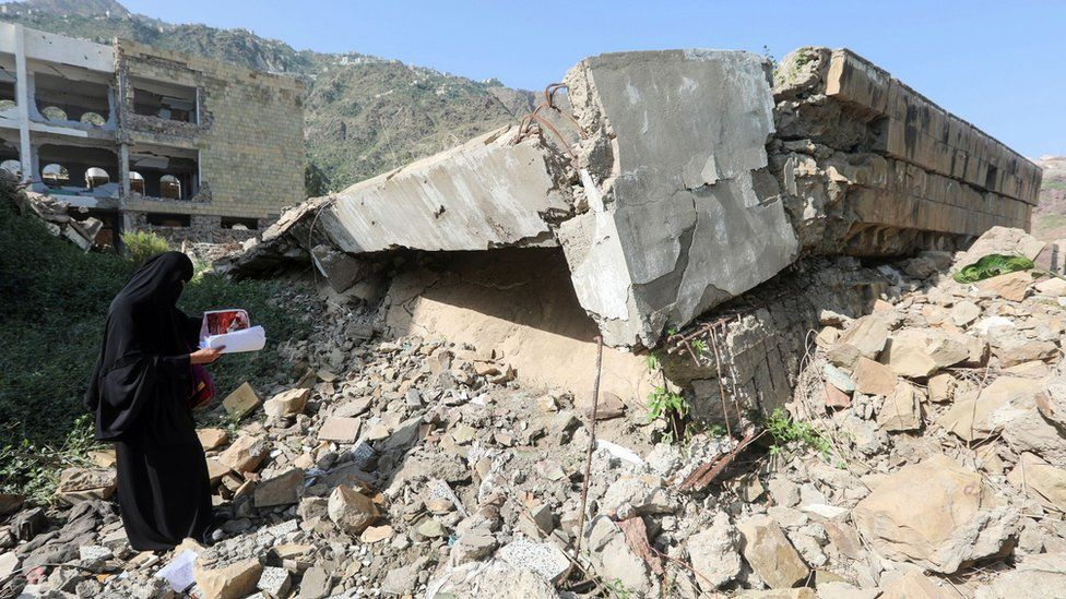 A Yemeni member of a school administration inspects the damage on the first day of the new academic year on September 16, 2018, at a school that was damaged last year in an air strike