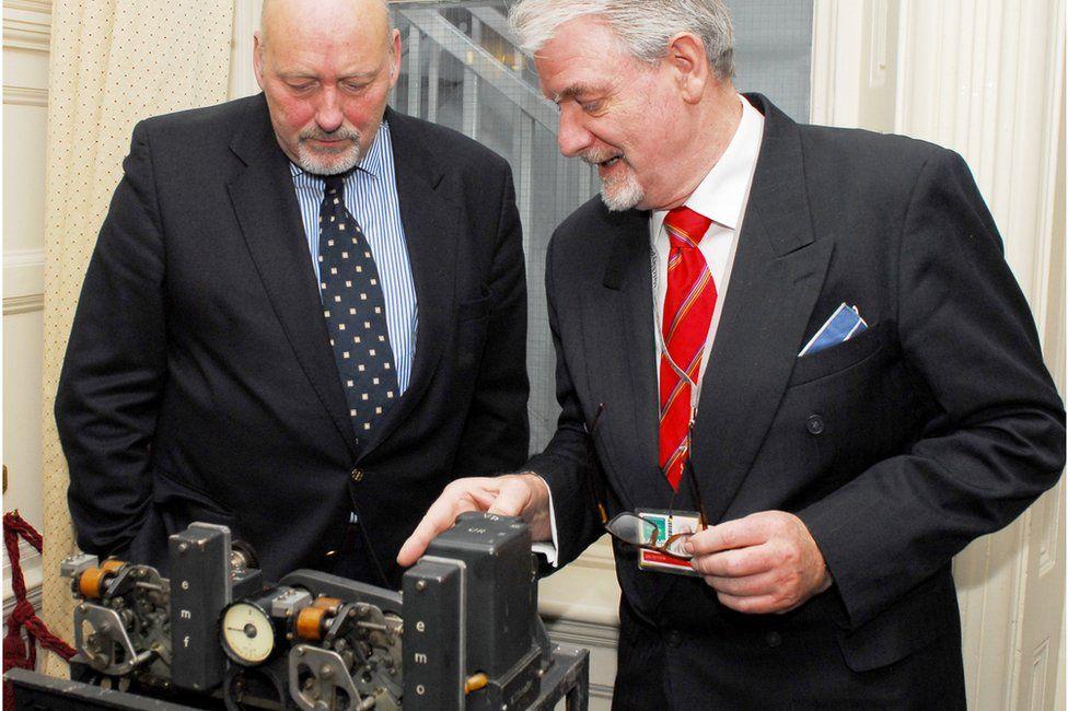 Volunteer John Watson shows the Lorenz machine to Bill Tutte, nephew of the wartime codebreaker of the same name