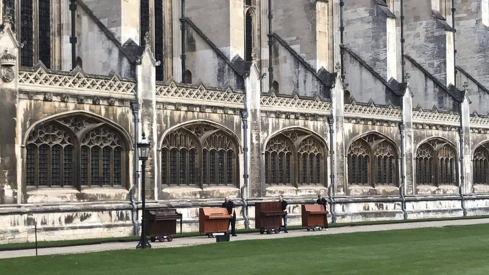 pianos being wheeled into King's College Chapel