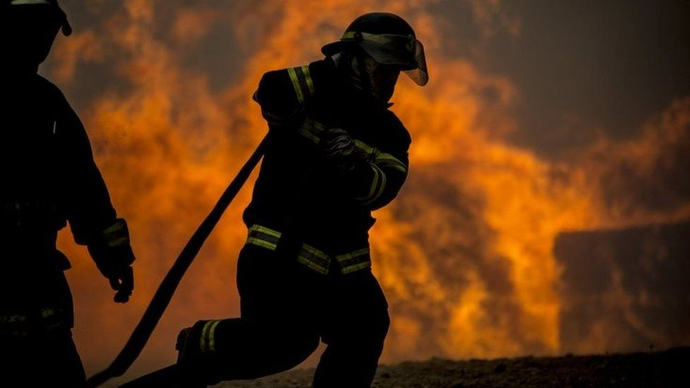 firefighters in Constitucion in southern Chile. 26 January 2017