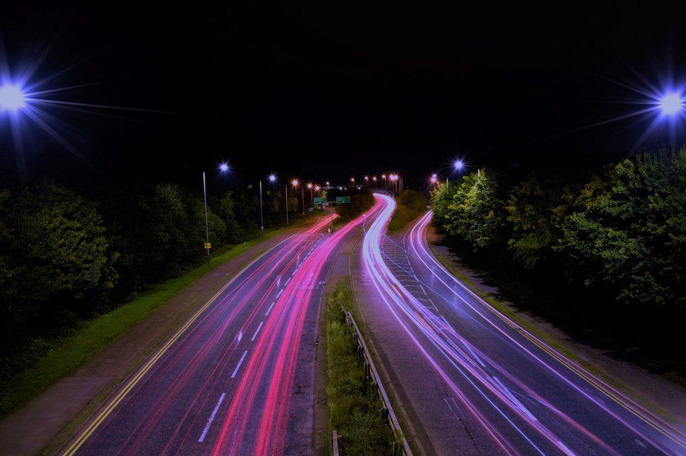 Car lights on a road