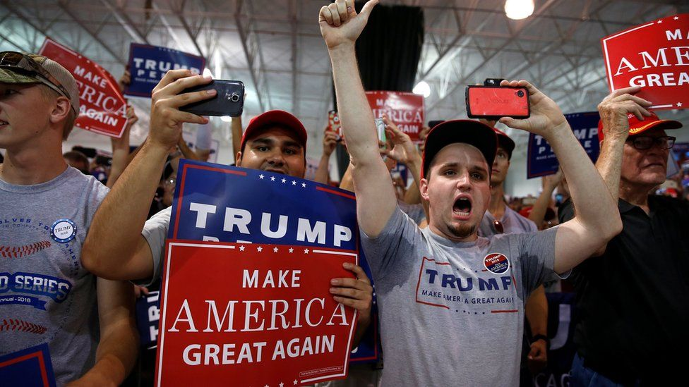 Supporters cheers as Republican presidential nominee Donald Trump walks on stage during a campaign event