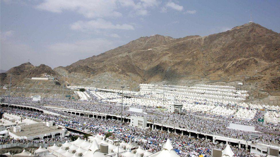 Pilgrims arrive at Mina for the 'Stoning of Satan' ritual during the Hajj pilgrimage