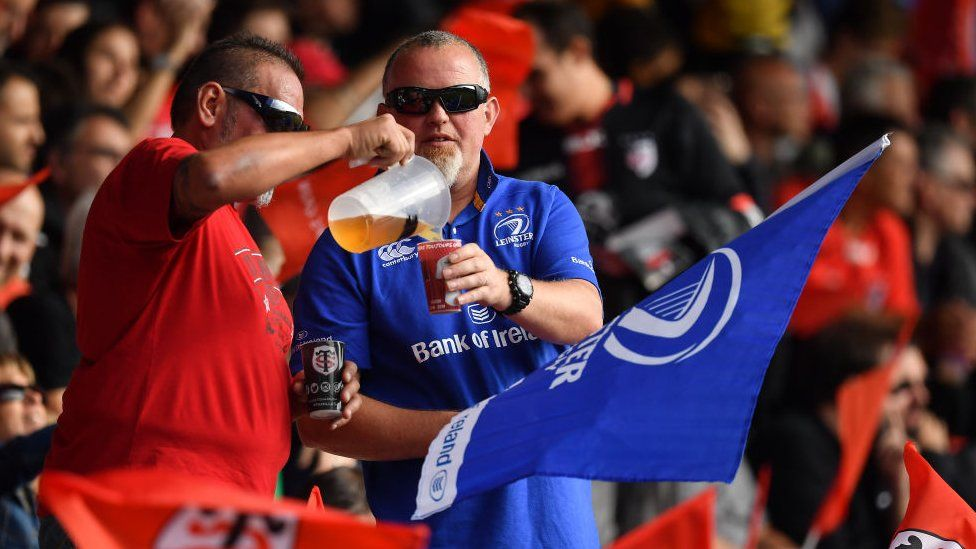 A Toulouse supporter and a Leinster supporter share a beer prior to the Heineken Champions Cup Round Pool 1 Round 2 match between Toulouse and Leinster at Stade Ernest Wallon
