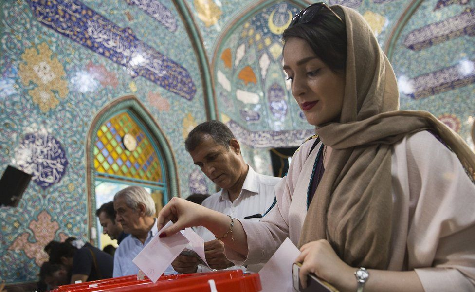 Iranian voters cast their ballots for the presidential and municipal council election on May 19, 2017 in the city of Qom, south of the capital Tehran, Iran