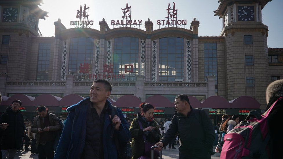People walk in front of the entrance of Beijing Railway Station on January 19, 2020 in Beijing, China