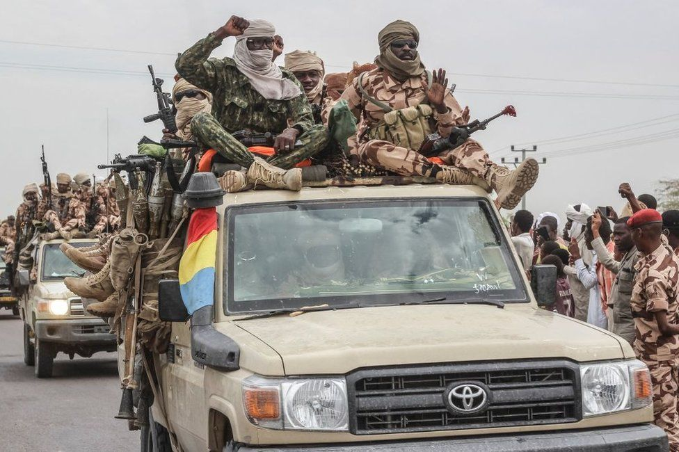 Chadian soldiers celebrate as they parade in N'Djamena on Sunday.