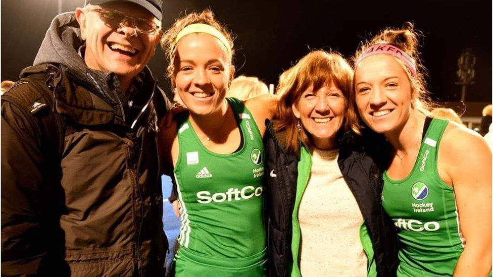 Bethany and Serena Barr pictured pitch-side with their mum and dad
