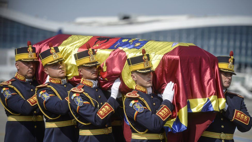 Honour guard soldiers carry the flag-draped coffin of Anne of Romania, before a religious service, in Otopeni, Romania
