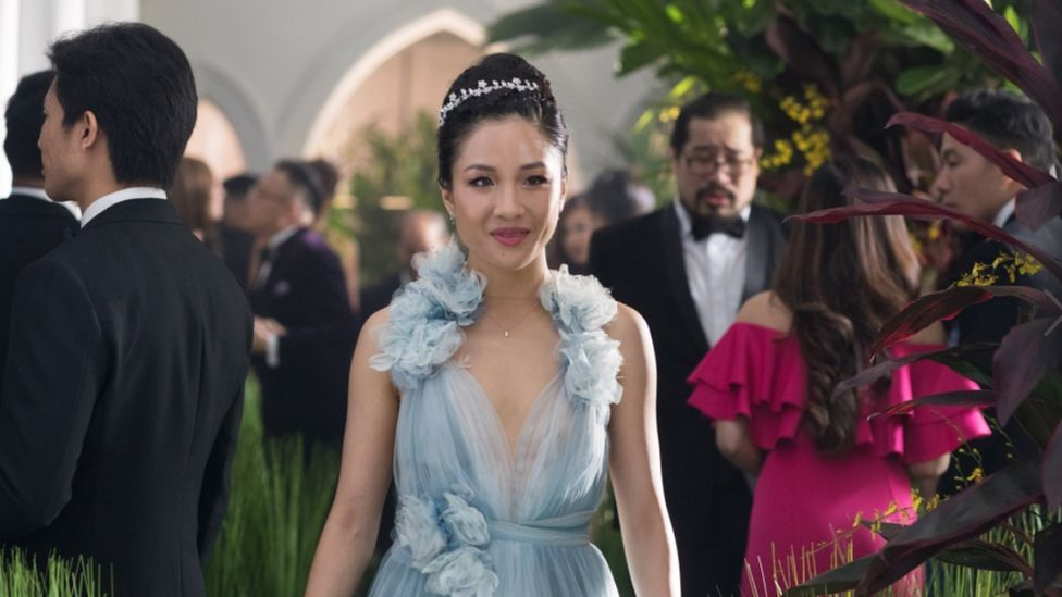 Movie still from Crazy Rich Asians showing Constance Wu smiling