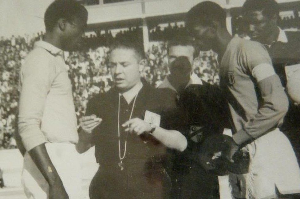 Referee talking to two players