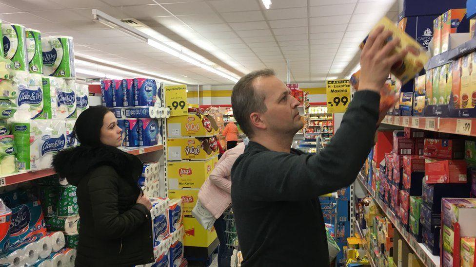 The Zedinek family, from the Czech Republic, shop in Altenberg, Germany
