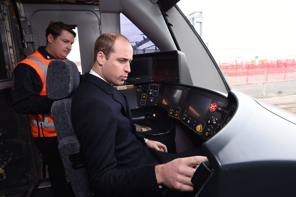 The Duke of Cambridge sounds the warning horn on a Crossrail train, which is destined to run on the Elizabeth Line in London, during a visit to Bombardier Transportation in Derby.