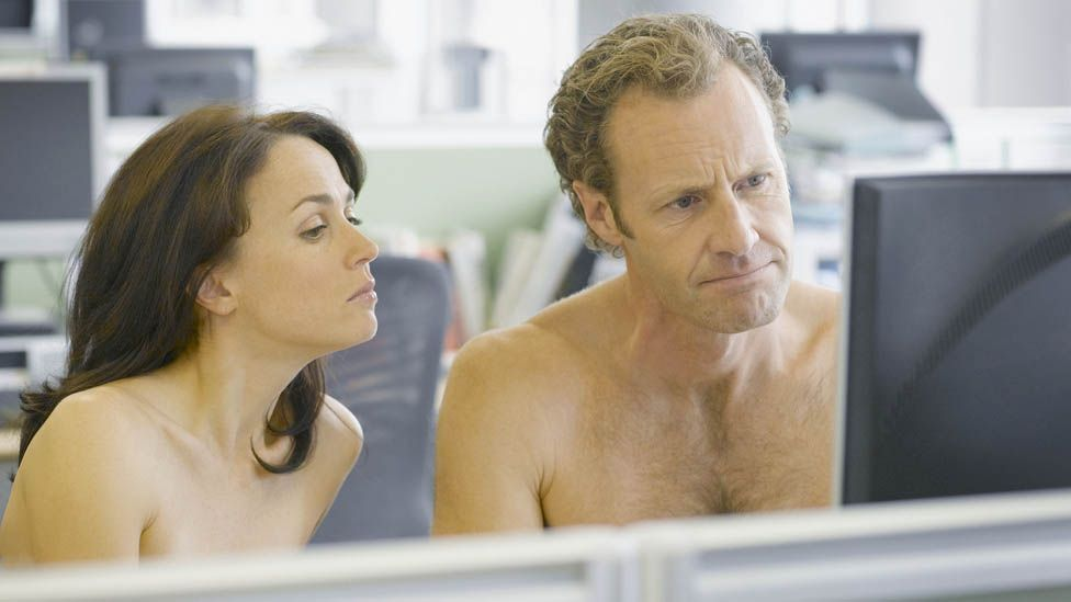 Naked people in an office