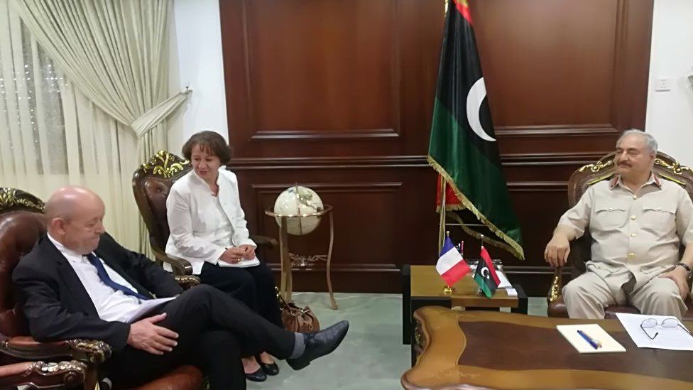 France's Foreign Minister Jean-Yves Le Drian (L) meets with Libya's Field Marshal Khalifa Haftar (R), whose self-styled Libyan Nationa
