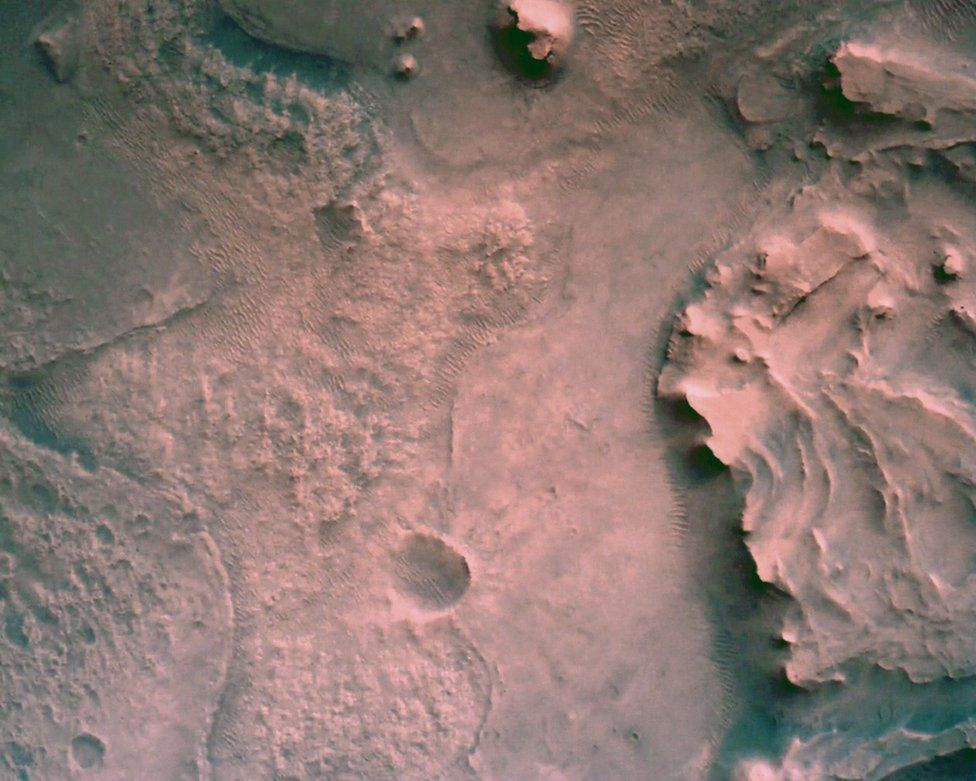 The surface of Mars directly below Nasa's Mars Perseverance rover is seen using the Rover Down-Look Camera