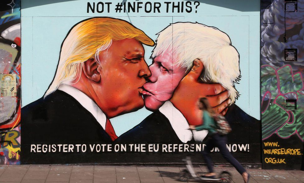 A mural showing US Republican presidential nominee Donald Trump (L) kissing the former Mayor of London and Conservative MP, Boris Johnson, on the side of a building in Stokes Croft area of Bristol, south west England on May 24, 2016