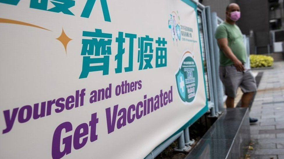 A man walks out of a community vaccination centre for the Sinovac Biotech Ltd. Covid-19 vaccine in Hong Kong