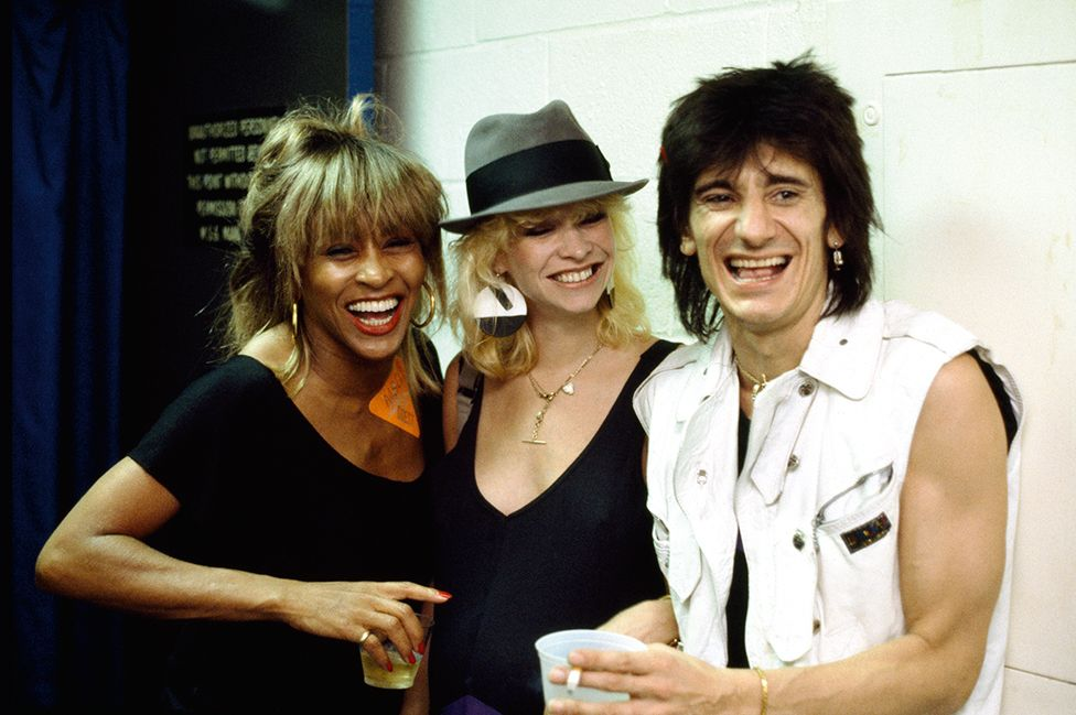 Tina Turner with Ronnie Wood of the Rolling Stones and wife Jo, backstage at Madison Square Garden