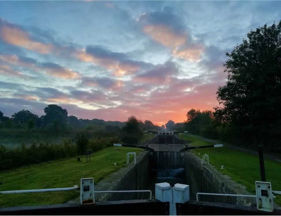 Sunrise over canal docks